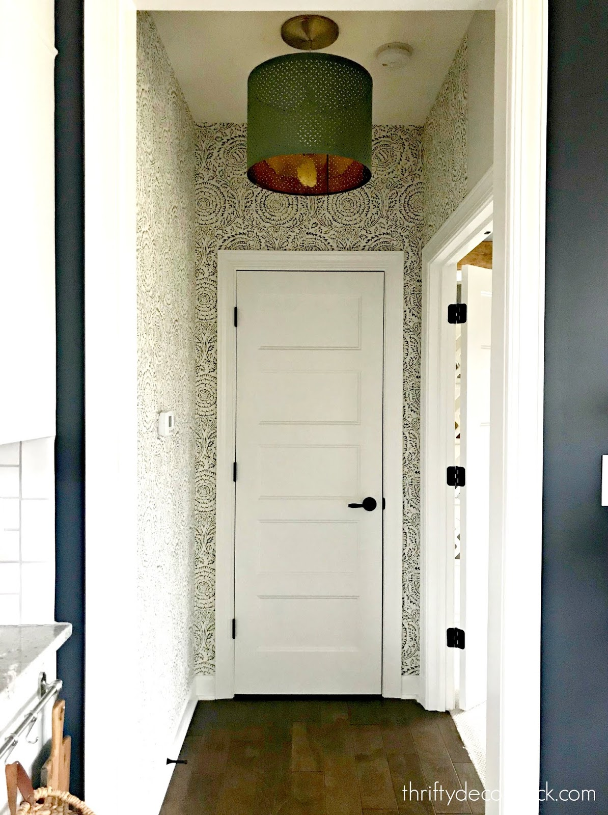 Wallpapered small hallway