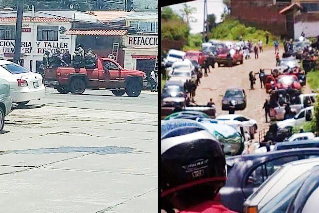 """BANDON de MAS de 100 DELINCUENTES """"BIEN ARMADOS"""" INCURSIONA en MAS de 30 CAMIONETAS en PATZCUARO MICHOACAN."""