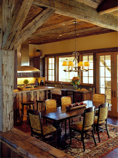 Appealing Chandelier above the Upholstered Dining Chairs and Long Wooden Table under the Wide Wooden Ceiling