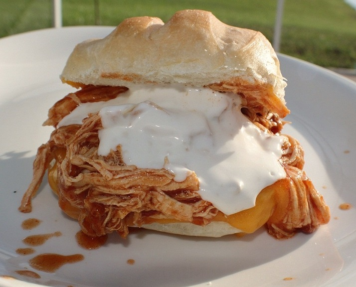 Chicken pulled with hot sauce in a bun with blue cheese dressing