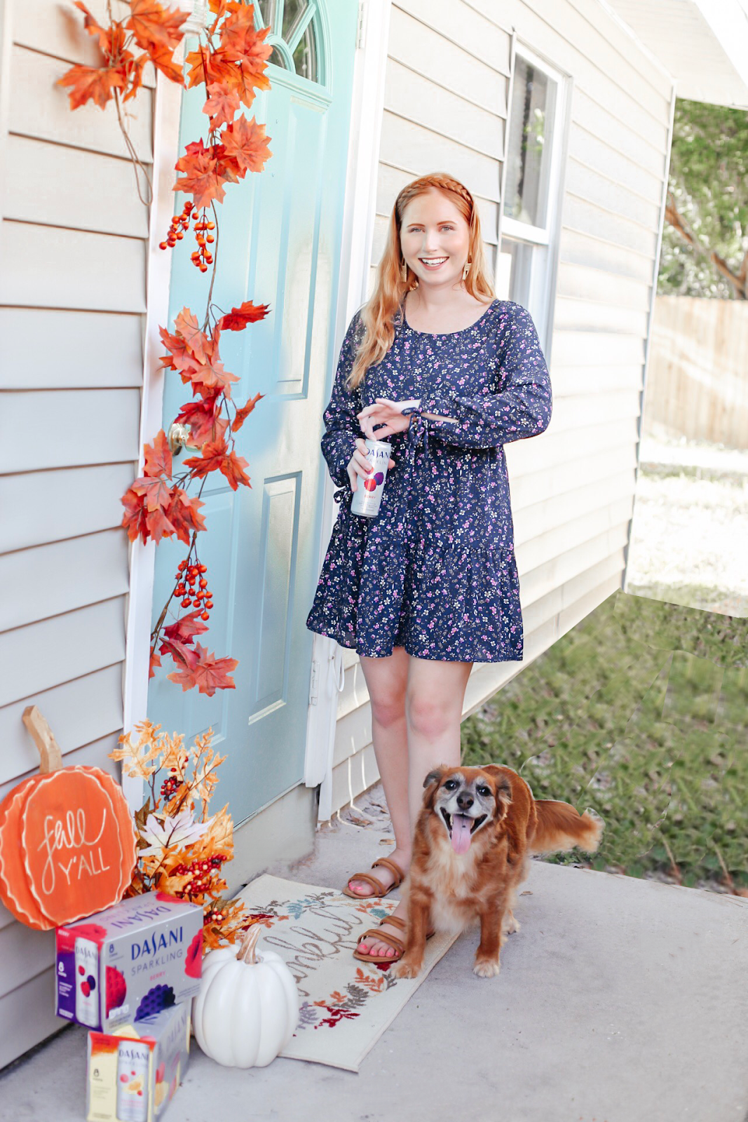 Fall Porch Decorating with Dasani Sparkling Water. Tampa Blogger, Amanda Burrows, Affordable by Amanda shares her fall porch decoring leaves and white pumpkins. She is also drinking Dasani Sparkling Berry sparkling water while she decors the front porch for fall.
