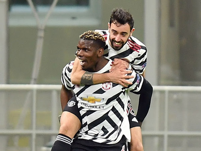 Paul Pogba and Bruno Fernandes celebrating Manchester United win over AC Milan