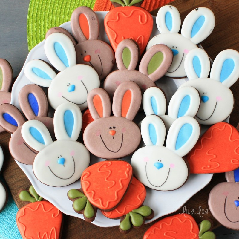 Decorated chocolate sugar cookies in Easter designs - bunnies and carrots