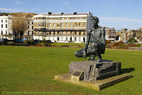 Mr H Phillips' statue of 'The Waiting Miner' on Marine Parade, Dover, Kent, England, facing the seafront, the harbour, and English Channel beyond. Originally located at Richborough Power Station in Kent. Donated by Powergen. Now at Fowlmead Country Park, Kent.