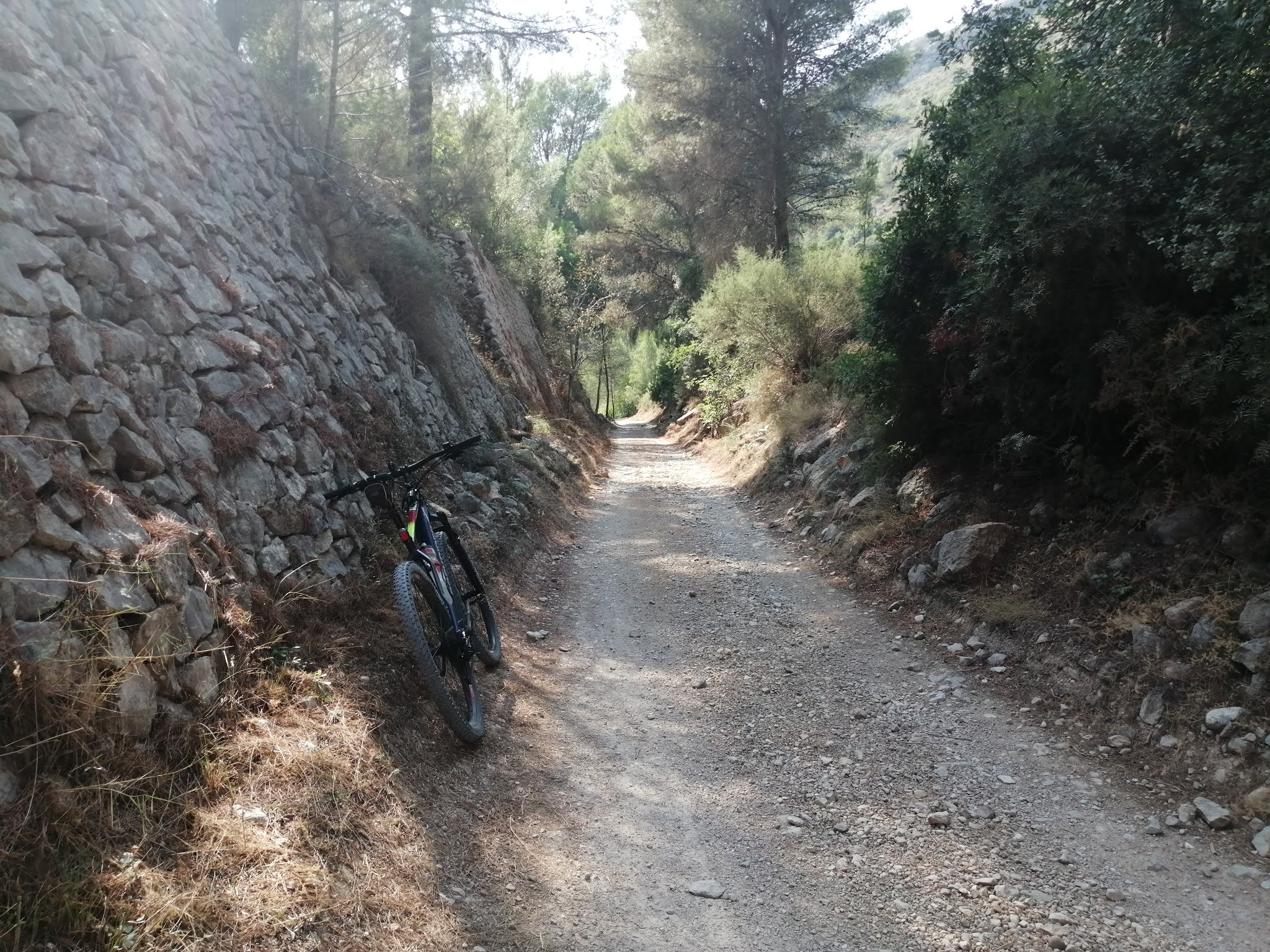 Stone-walled railway cutting on the River Serpis Greenway, Spain