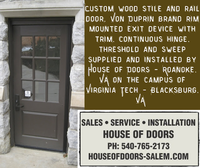 Custom wood stile and rail door, Von Duprin brand rim mounted exit device with trim, continuous hinge, threshold and sweep supplied and installed by House of Doors - Roanoke, VA on the campus of Virginia Tech - Blacksburg, VA