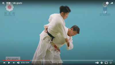 Picture of Judoka looking in the direction (away from Uke and down) whilst perfoming Uki Goshi