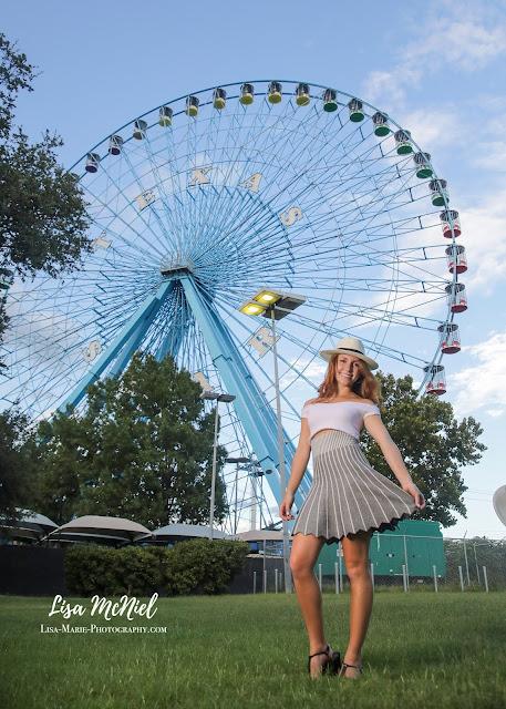 teen girl in front of roller coaster