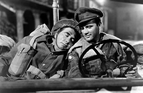 Robert Newton and Richard Burton as British soldiers in a jeep