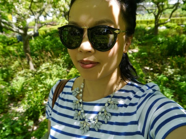 Casual travel style: Breton stripes, statement necklace, and Karen Walker 'Harvest' shades