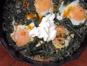 Skillet-Baked Eggs with Spinach, Chili Oil, and Yogurt