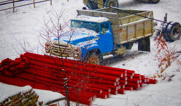 red pipe-lines brought by the vehicles