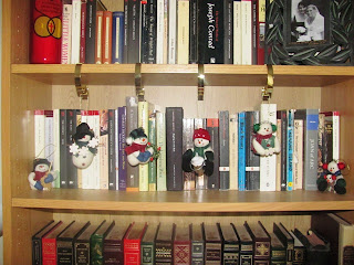 First Sunday of Advent|image of Christmas ornaments on a bookcase