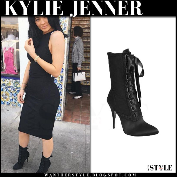 Kylie Jenner in black dress and black lace up ankle boots giuseppe zanotti x balmain what she wore