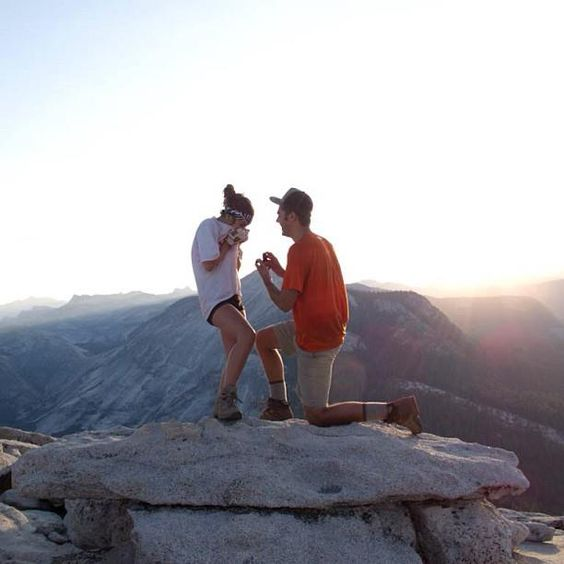 Beautiful High Place for Romantic Propose - Nice view, man in red shirt while the woman in white shirt, mini shorts