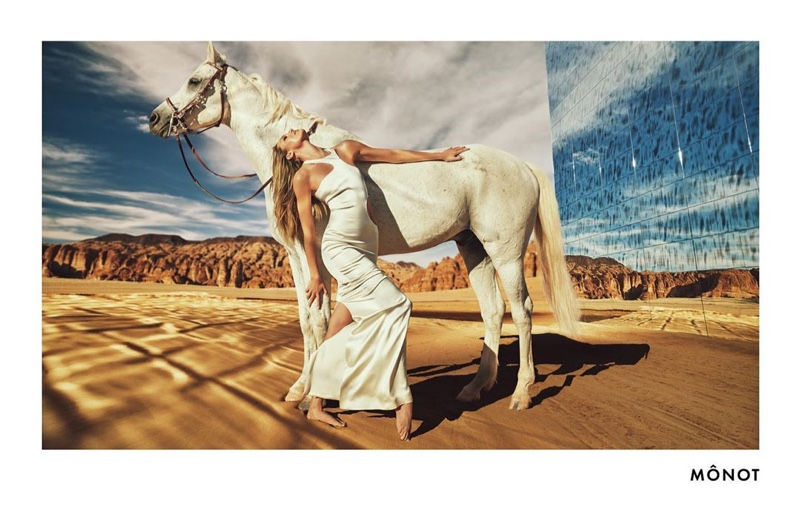 Candice Swanepoel poses with a horse in Mônot fall-winter 2020 campaign.