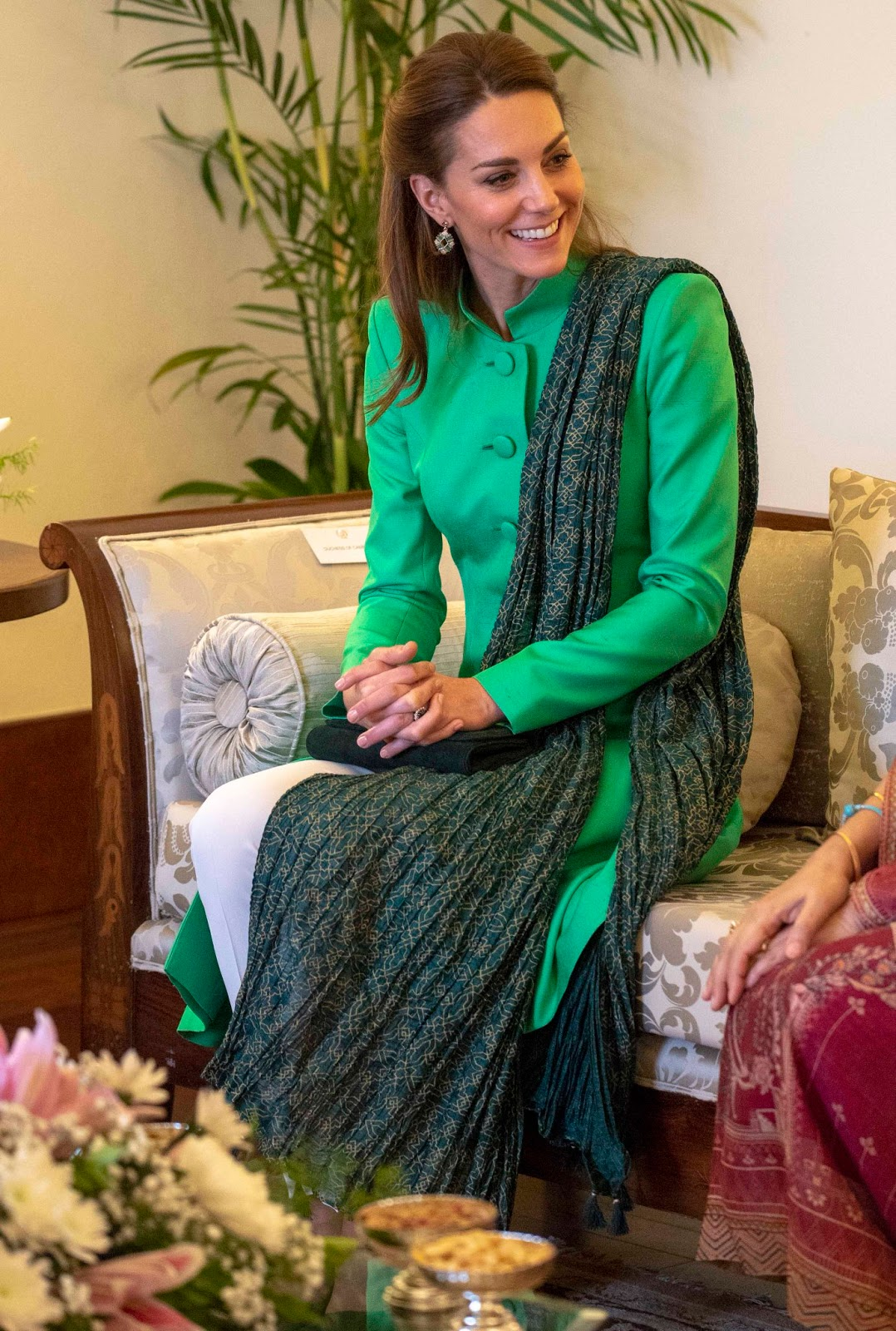 Kate Middleton wears a Catherine Walker tunic, Maheen Khan trousers, Satrangi scarf and Zeen earrings