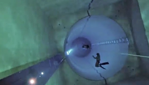 Divers trying to reach the bottom part of Y-40.