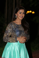 Nikki Galrani in Green Skirt  Top at Marakathamani music launch ~  Exclusive (70).JPG