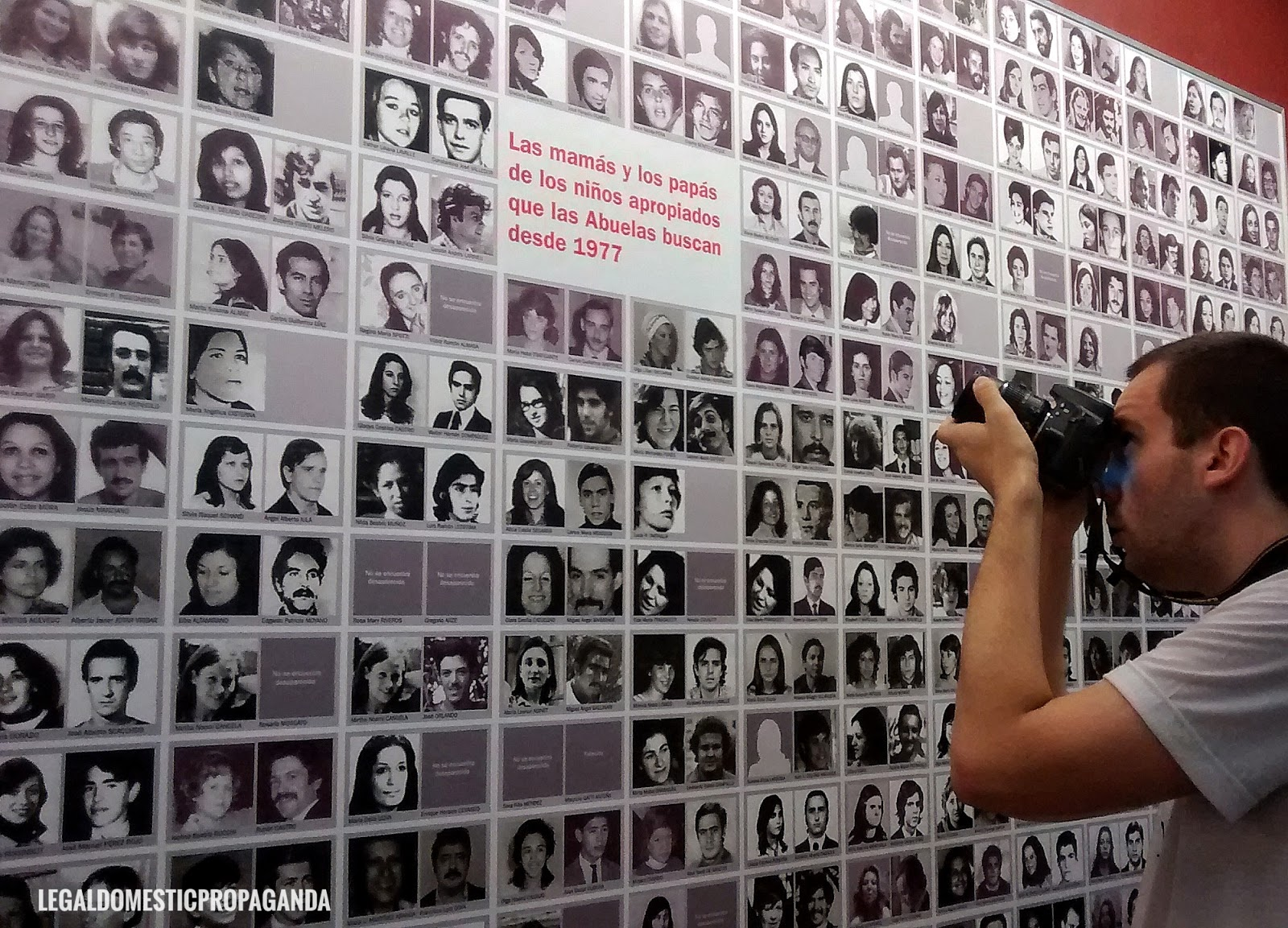 Man photographs wall of pictures