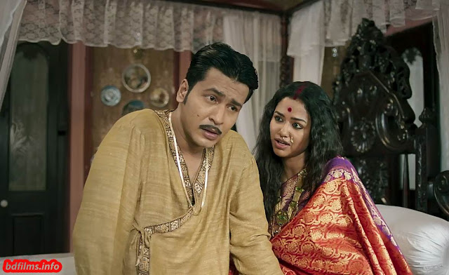 Manbhanjan (2019) is an Indian Bengali art and drama film directed by Abhijit Chowdhury in 2019. The film is made based on the same name short story of the world poet Rabindranath Tagore. The film is starred by Anirban Bhattacharya, Amrita Chattopadhyay and Sohini Sarkar in the lead roles. The film is produced by Shree Venkatesh Films.  Plot Three characters are leading the movie Gopinath Seal, Giribala and Lobongo. Gopinath is an only son of a Zamindar family and Giribala is his wife. Gopinath has inherited a lot of properties. But he has lost all the properties even his wife. He makes an illegal relation with the theatre star Lobongo and Lobongo also yields her to Gopinath only for money and treasures. But Giribala could not tolerate his husband's aggressiveness. So, she left the Zamindar house and started theatre with the name 'Adhoro Bala'. Gopinath lost his property and house, court seizes his properties and house. At last he has to fall in front of Giribala at the theatre.  Watch the full movie Manbhanjan (2019) Indian Bengali movie here…