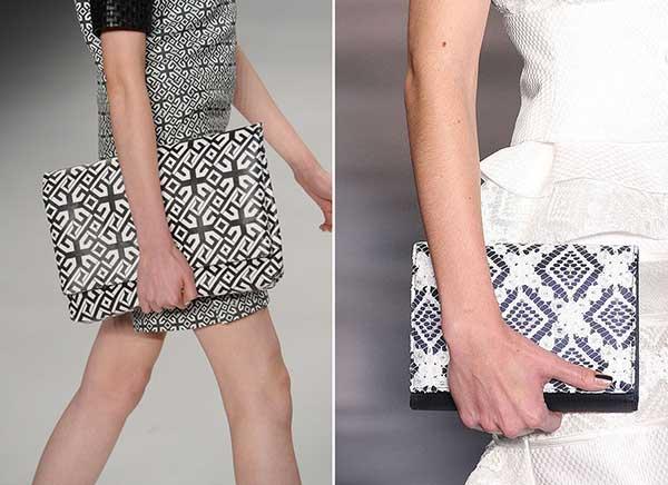 Bolsa Carteiro preta e branca com grafismo.