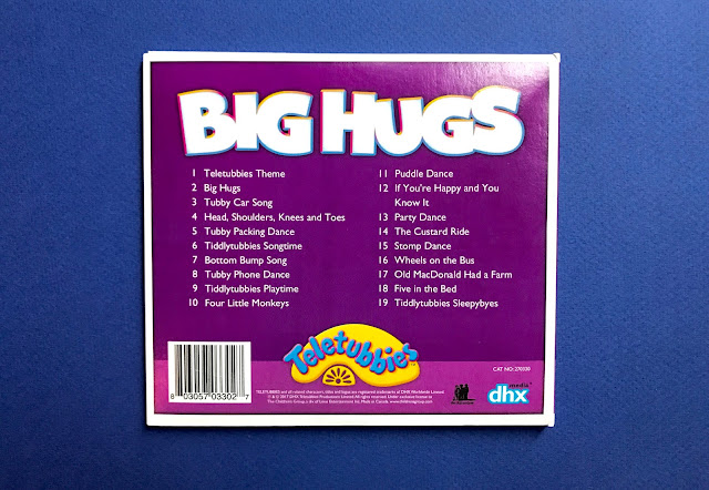 Back view of the Big Hugs CD case showing the names of all 19 songs