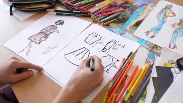 Sketching by fashion designer