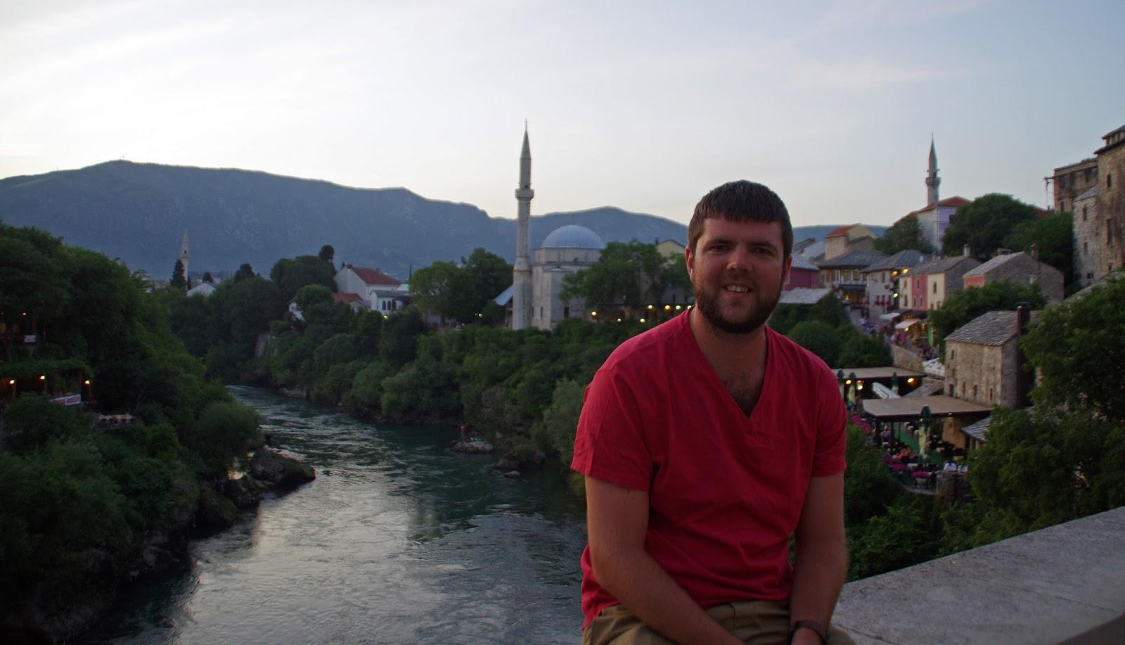 Boy sitting on Stari Most Mostar