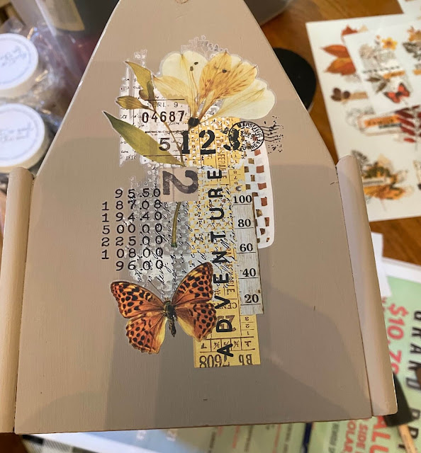Photo of a fall decor transfer applied to a toolbox end.