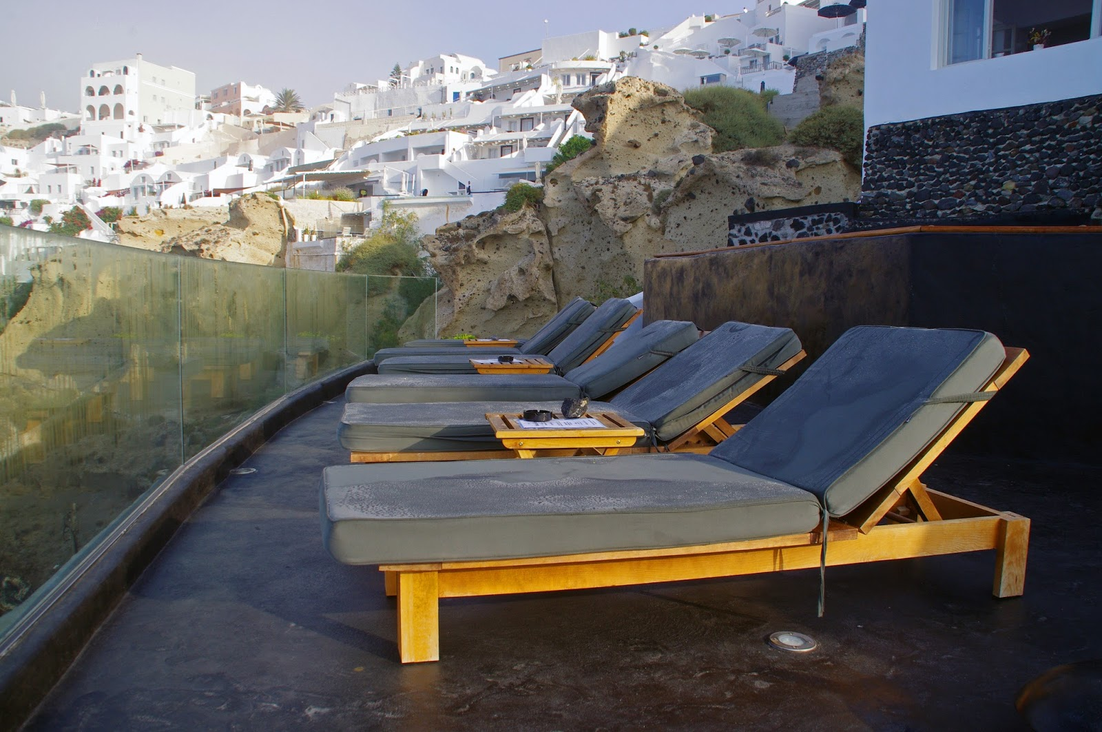 Deck chairs at Nostos Apartments Oia Santorini