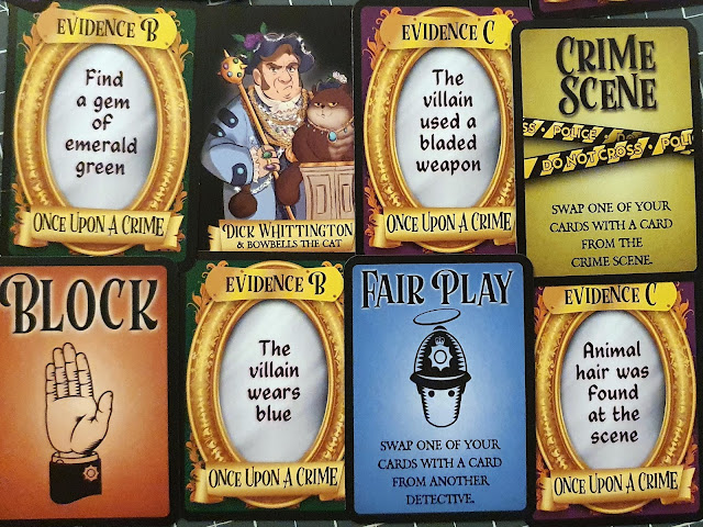 Foul Play Card Game evidence and other cards laid out 2 x 4