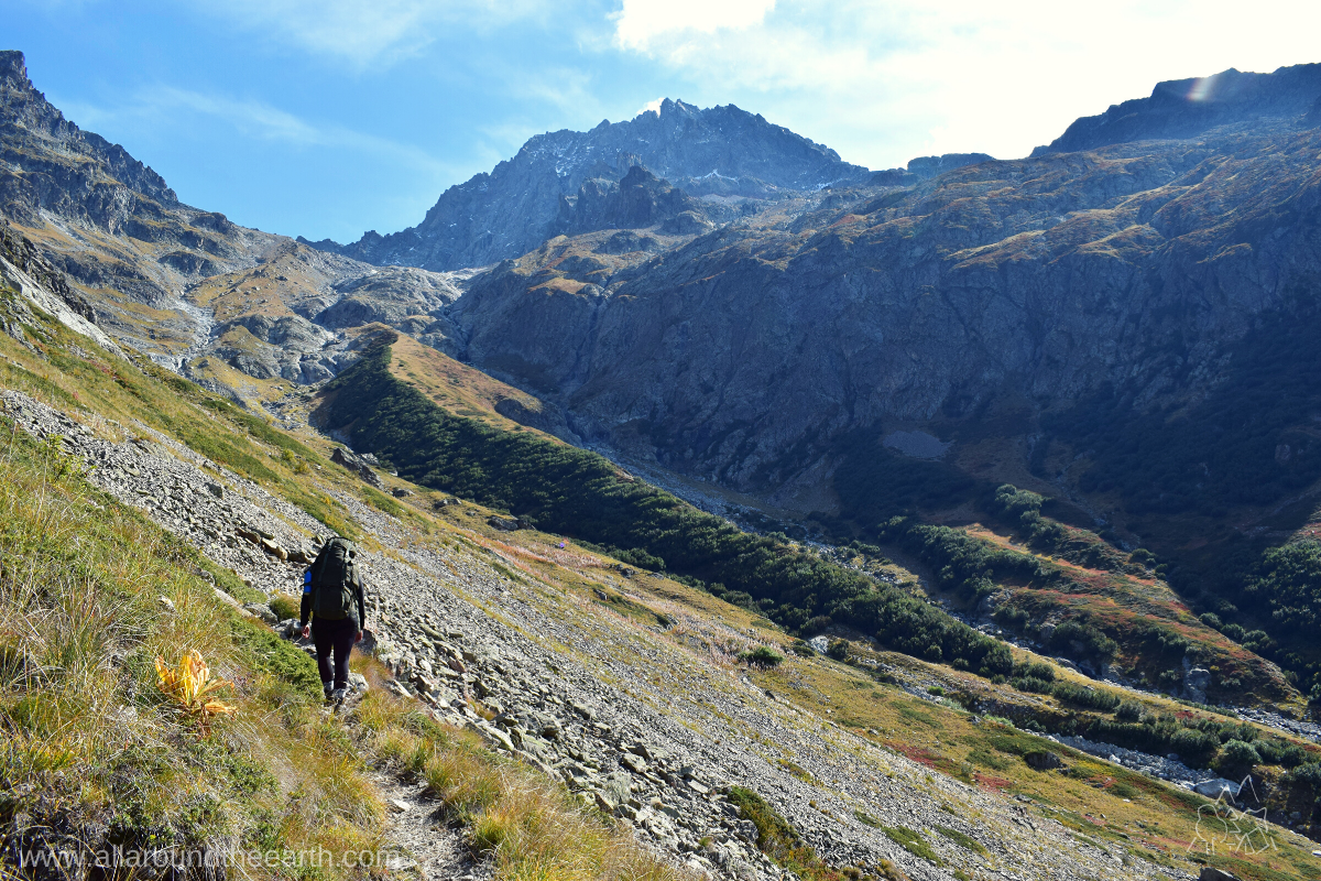 Hiker making her way to Cabane du Pis in the Valgaudemar Valley in the Écrins National Park in the French Alps