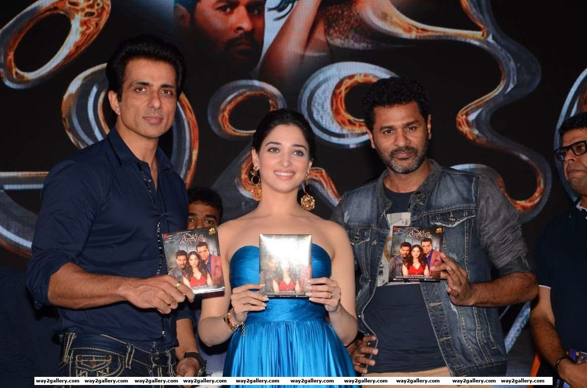 Sonu Sood Tamannaah Bhatia and Prabhudeva pose for photographers during the audio launch of Abhinetri