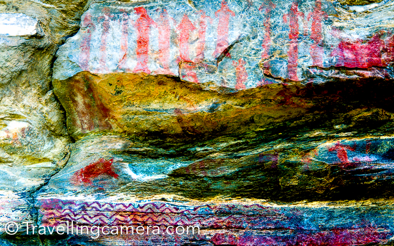 During our recent trip to Binsar, we also visited Jageshwar temples and on our way back to Almora we stopped at Barechhina village to see old rock paintings. This Photo Journey shares more about the place, rock paintings, how to reach and other things to do around Almora region of Kumaon.Barechhina is a village in Almora district, which is 18 km from the city of Almora.  This place is on highway from Almora to Munsiyari.Please note that paintings don't look as vibrant as you see in these photographs. Photographs are processed after clicking to ensure that everyone notices these paintings. When you visit this place, it would take some time to locate these paintings.This was on our way from Jageshwar to Almora/Binsar. I noticed lot of folks skip it, but we chose to stop and see what exactly is there in these caves. It's hardly 100 meters walk from road.Barechhina is popularly known for its two pre-historic painted rock shelters on the banks of Suyal river. These caves have paintings of animals, humans painted with fingers in black, red and white colors and engravings of trishul and Swastika.These caves are located on a high hill, from where you can see the river and green landscapes all around. This part of Almora is full of pine forests and Barechhina is also surrounded by pine forests.These rock paintings have now become a tourist attraction and also a site for archaeological rock engravings being studied by Indira Gandhi National Centre for the Arts, New Delhi.