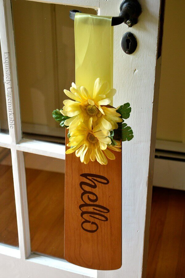 Yellow Flower on a fan blade with Hello stenciled on it