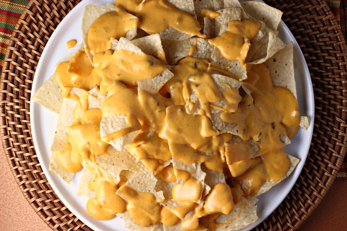 Chipotle Ranch Bacon Cheddar Nachos   by Renee's Kitchen Adventures - Easy recipe for a delicious appetizer or fun main dish the whole family will love!  Cheesy goodness with every bite! #SimmeredinTradition