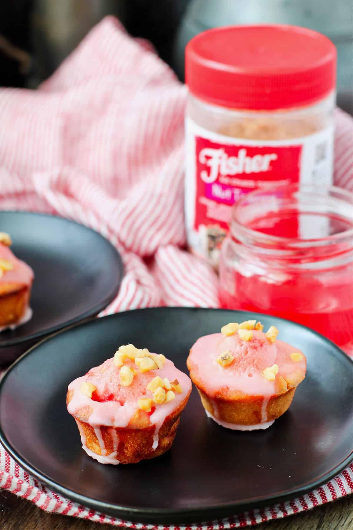 Maraschino cherry muffins on plates.