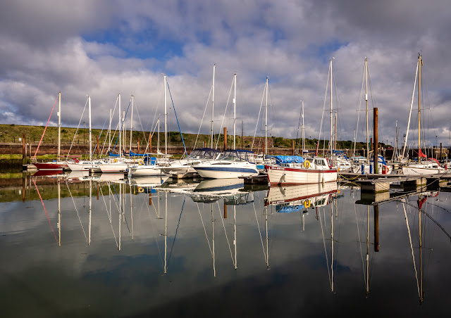 Photo of reflections in the calm water at Maryport Marina on Tuesday morning