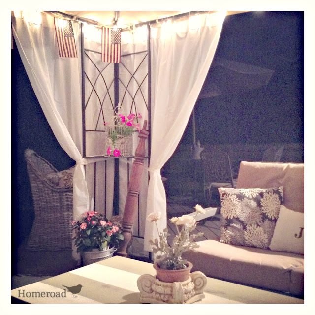 Night view of outdoor gazebo with curtains