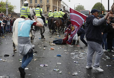 police on horses try to calm things in attack of man united bus by west ham fans