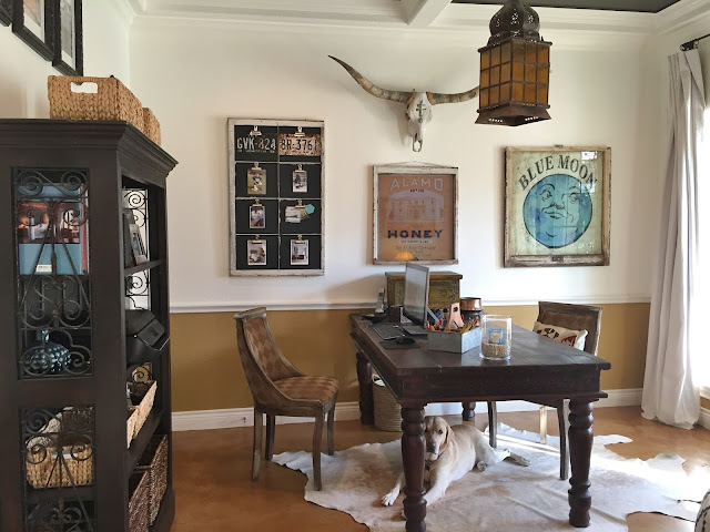 Texas inspired home office, cowhide rug, longhorn skull, rustic study ideas