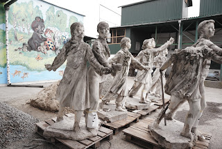 Dismantled figures of an old sculpture 1