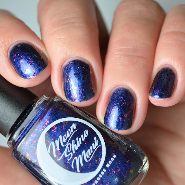 blue multichrome nail polish four finger swatch