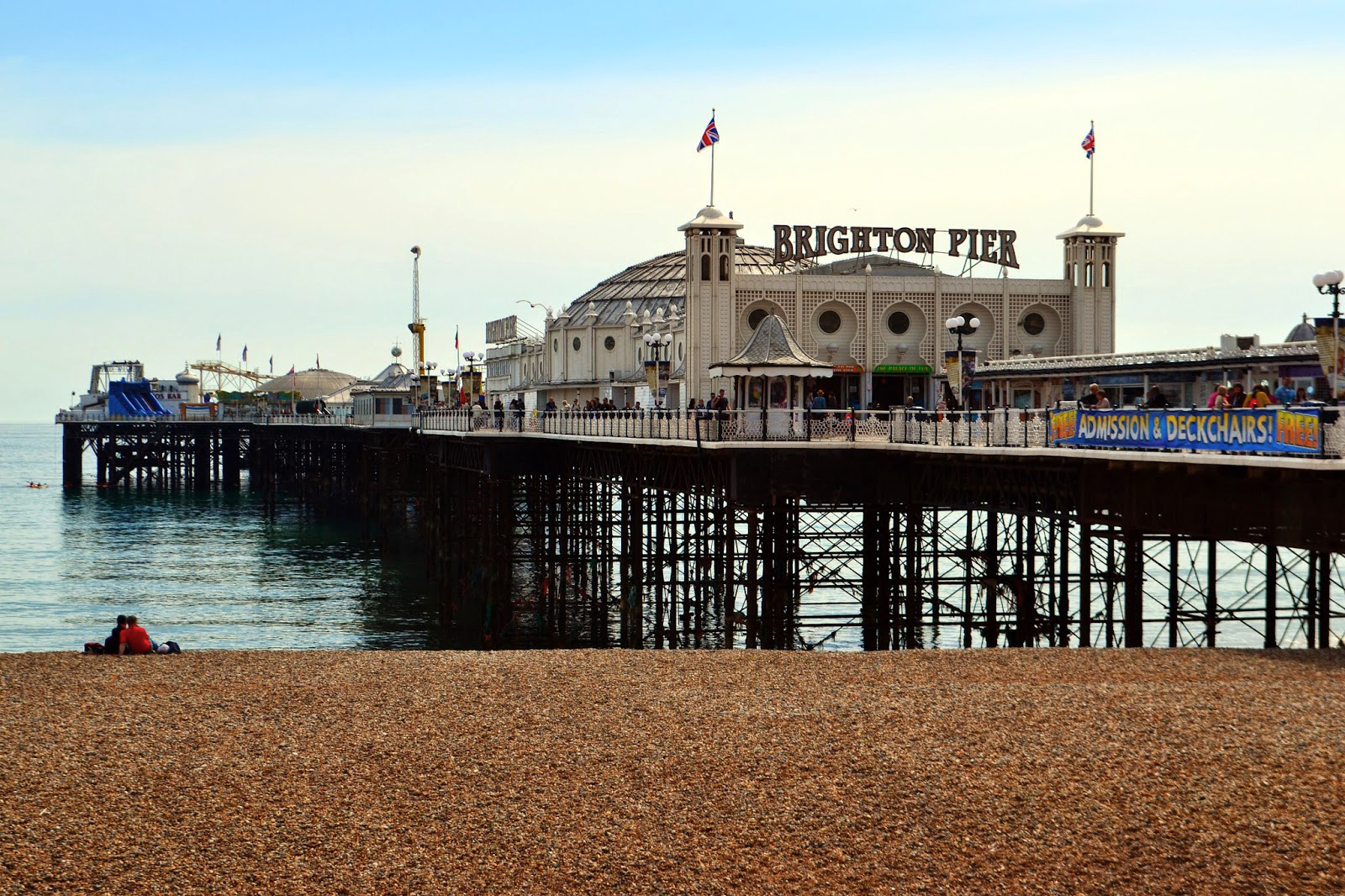 Looking across the shingle beach over to Brighton Pier.