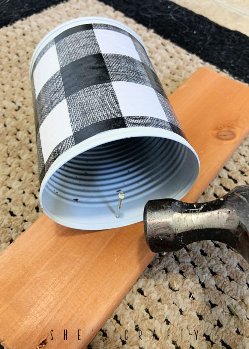 how to make a hole in a metal can with a nail.