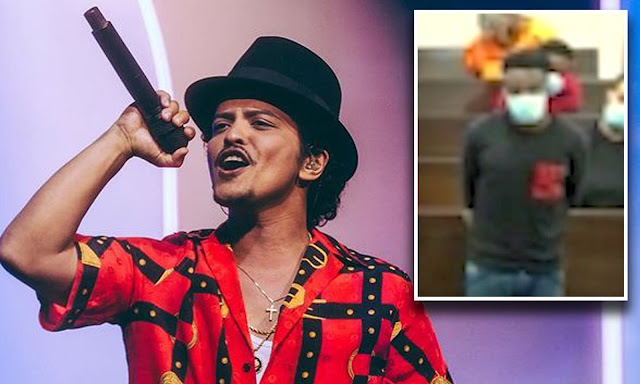 Two Nigerians arrested after duping a 63yr old Texas woman with a sum of $100,000 for pretending to be Bruno mars