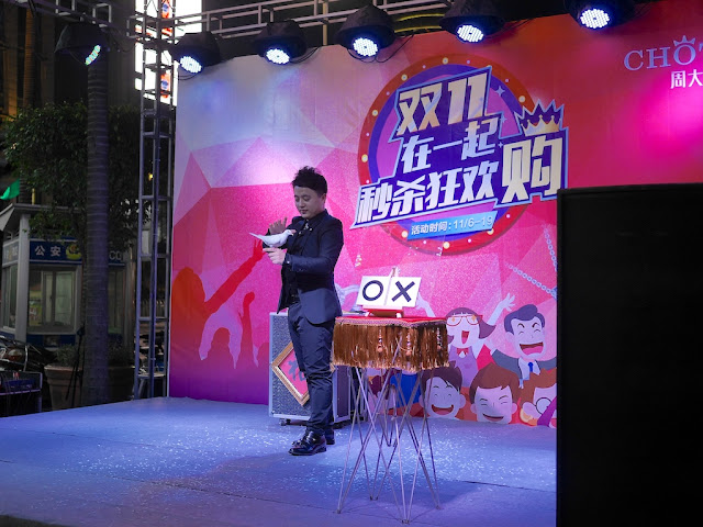 magician with a white dove dancers at Chotef (周大发) promotion for Singles Day in Zhongshan