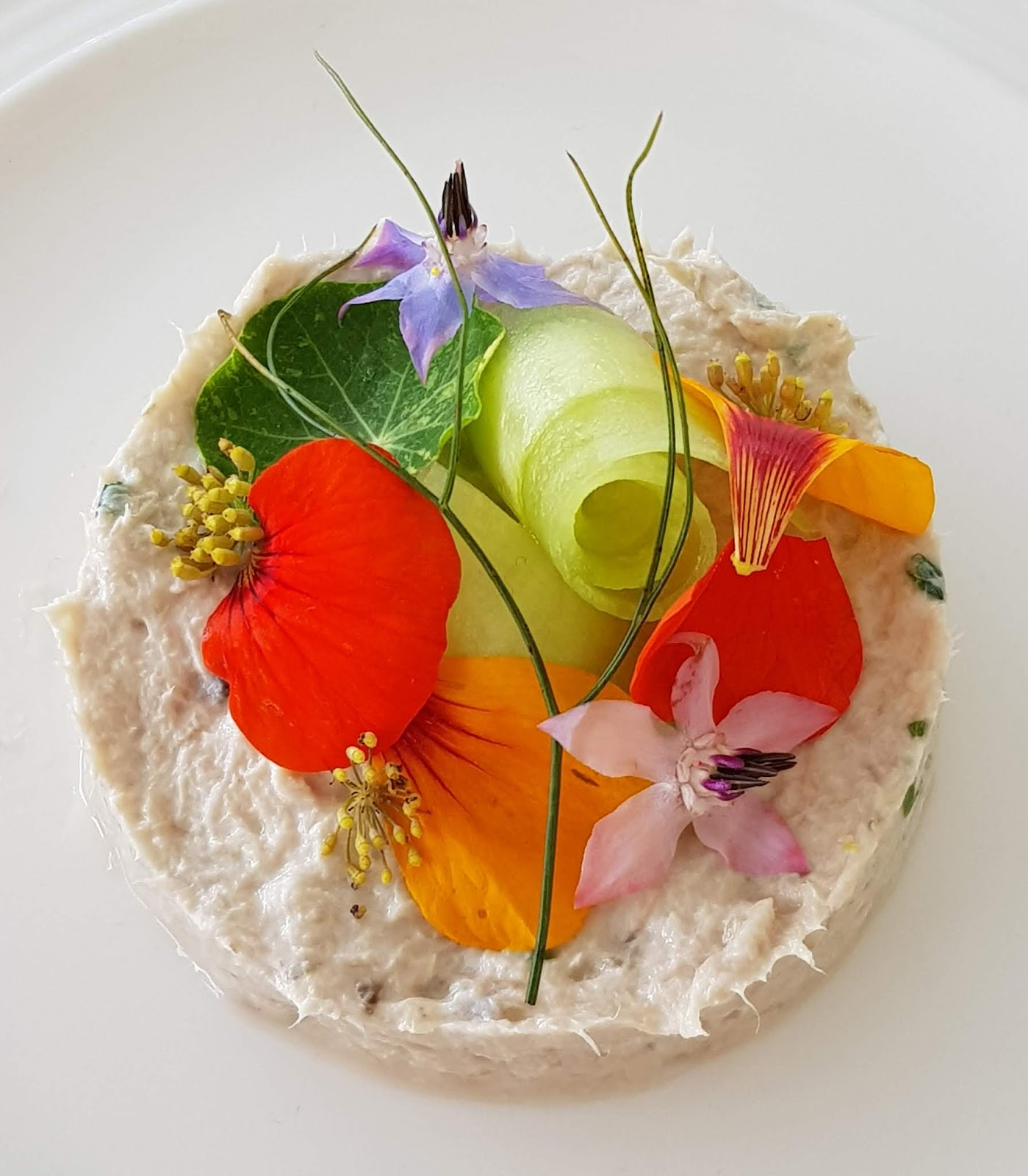 Starter of mackeral pate with flowers from the Horn of Plenty, Devon