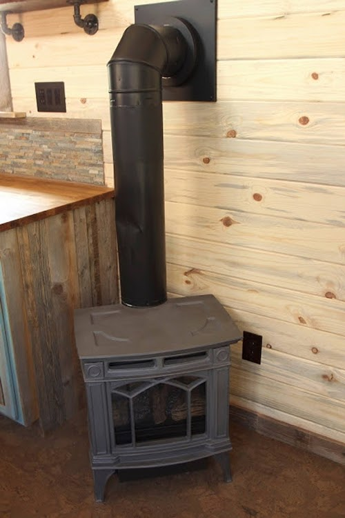 05-Wooden-Stove-Sustainable-Architecture-with-a-Tiny-House-on-Wheels-www-designstack-co